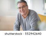 smiling senior man with... | Shutterstock . vector #552942640