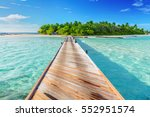 wooden jetty towards a small... | Shutterstock . vector #552951574