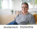 smiling senior man with... | Shutterstock . vector #552965956