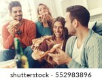 friends eating pizza.they are... | Shutterstock . vector #552983896