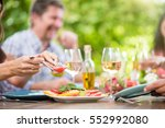 close up on hands serving... | Shutterstock . vector #552992080