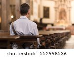Man sitting in a pew at church...