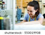 smiling young woman sewing with ... | Shutterstock . vector #553019938