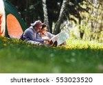 couple camping. young couple... | Shutterstock . vector #553023520