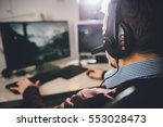 man wearing headphones and... | Shutterstock . vector #553028473