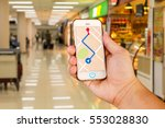 man is holding mobile phone...   Shutterstock . vector #553028830