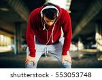 young man resting after running | Shutterstock . vector #553053748