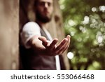 Small photo of Giving a helping hand, asking or offering help close-up shot of a Caucasian man in a business suit.