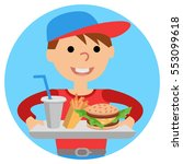boy carries a tray of food.... | Shutterstock .eps vector #553099618