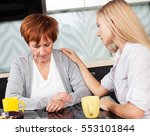 daughter soothes sad mother.... | Shutterstock . vector #553101844