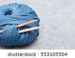 Ball Of Blue Yarn And Knitting...