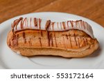 Small photo of Eclair Eclair with chocolate dairy eclair