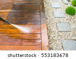 cleaning terrace with a power... | Shutterstock . vector #553183678
