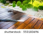 cleaning terrace with a power... | Shutterstock . vector #553183696