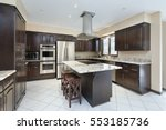 Stock photo kitchen in suburban home with stove top island 553185736