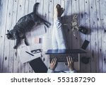 Stock photo creative space girl with her cat working from home 553187290
