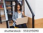 smart cute young woman sitting... | Shutterstock . vector #553195090