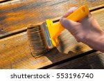 oiling terrace with wide brush  ... | Shutterstock . vector #553196740