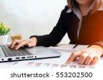business woman analyzing... | Shutterstock . vector #553202500