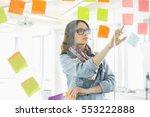 creative businesswomen reading... | Shutterstock . vector #553222888