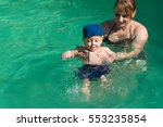 beautiful young mother with son ... | Shutterstock . vector #553235854