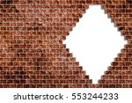 hole in a old brick wall... | Shutterstock . vector #553244233