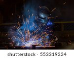 worker is welding automotive... | Shutterstock . vector #553319224