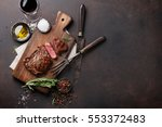 grilled ribeye beef steak with... | Shutterstock . vector #553372483