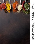 various spices spoons on stone... | Shutterstock . vector #553372498
