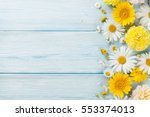 Stock photo garden flowers over blue wooden table background backdrop with copy space 553374013