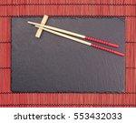 Chopsticks On Black Slate...