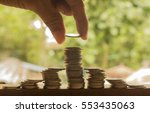 hand stacking of coins concept...   Shutterstock . vector #553435063