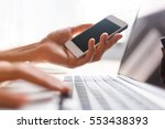 hands using laptop and phone...   Shutterstock . vector #553438393