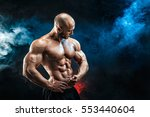 strong bald bodybuilder with... | Shutterstock . vector #553440604