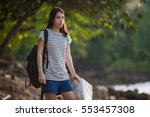 young woman with backpack... | Shutterstock . vector #553457308