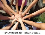 group of young people putting ... | Shutterstock . vector #553464013