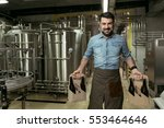 happy man holding bottles of... | Shutterstock . vector #553464646