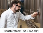 concentrated man pressing a... | Shutterstock . vector #553465504