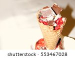 ice cream in a waffle cone with ... | Shutterstock . vector #553467028