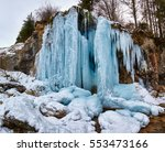 Frozen waterfall in winter time in the mountains - stock photo