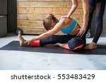 yoga class instructor helps... | Shutterstock . vector #553483429