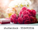 Stock photo red roses flowers with valentine festival gift and beautiful blur bouquet background 553493536