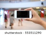 using smartphone in a market or ... | Shutterstock . vector #553511290