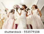 bride and bridesmaids with... | Shutterstock . vector #553579108