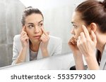 reflection in the mirror. woman ... | Shutterstock . vector #553579300