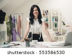 smiling tailor at her workshop. | Shutterstock . vector #553586530