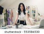 smiling tailor at her workshop. | Shutterstock . vector #553586530