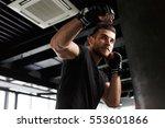 male exercising in boxing gloves | Shutterstock . vector #553601866