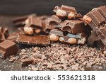 pile of chocolate with hazelnut   Shutterstock . vector #553621318