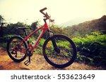 riding mountain bike on forest...   Shutterstock . vector #553623649